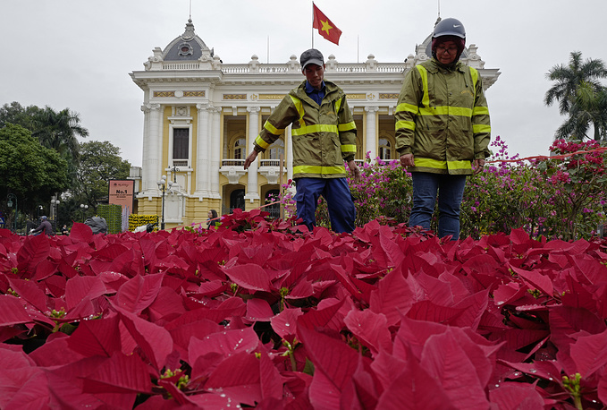 Workers decorate with flowers outside the Opera House ahead of the North Korea-US summit in Hanoi