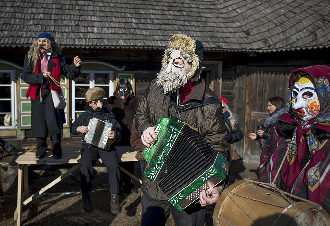 Revellers play accordions during Shrovetide celebrations in Lithuania