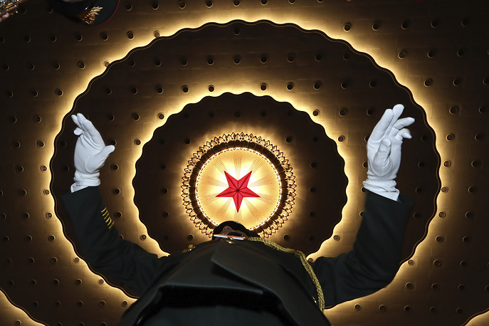 A Chinese military band conductor rehearses before the opening session of the annual National People's Congress in Beijing's Great Hall of the People, March 5