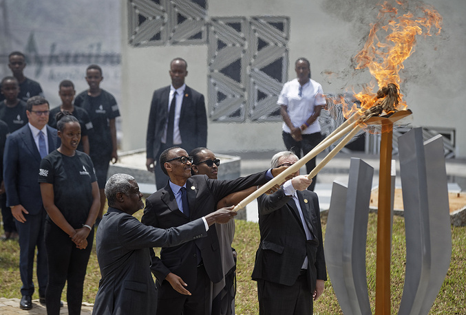 Chairperson of the African Union Commission Moussa Faki Mahamat, Rwanda's President Paul Kagame, Rwanda's First Lady Jeannette Kagame and President of the European Commission Jean-Claude Juncker, lighting the flame of remembrance at the Kigali Genocide Memorial in Kigali, Rwanda