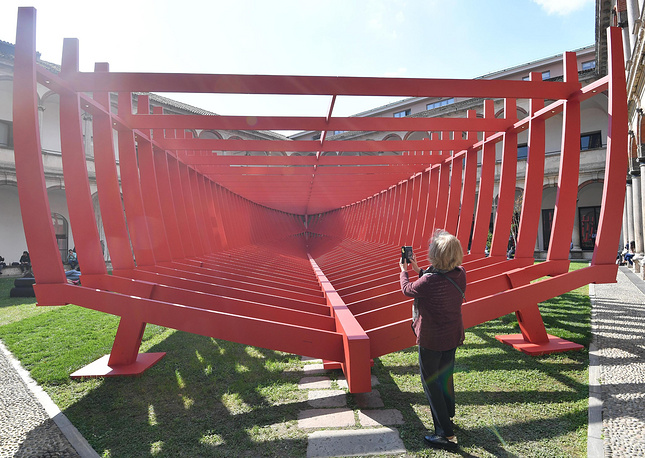 A visitor look at the installation 'From Shipyard to courtyard' by Lissoni Associati