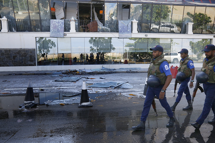 Sri Lankan Security personal passing the damaged Kingsbury Hotel in Colombo