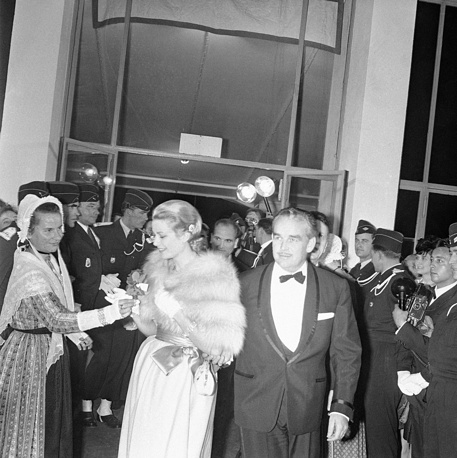 Prince Rainer III and Princess Grace of Monaco (formerly known as Hollywood star Grace Kelly) arriving at the gala opening the Cannes Film Festival, 1960