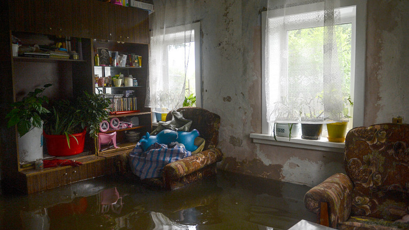 August 25. A flooded house in Khabarovsk district Krasnaya Rechka. Photo ITAR-TASS/ Olga Egoraeva