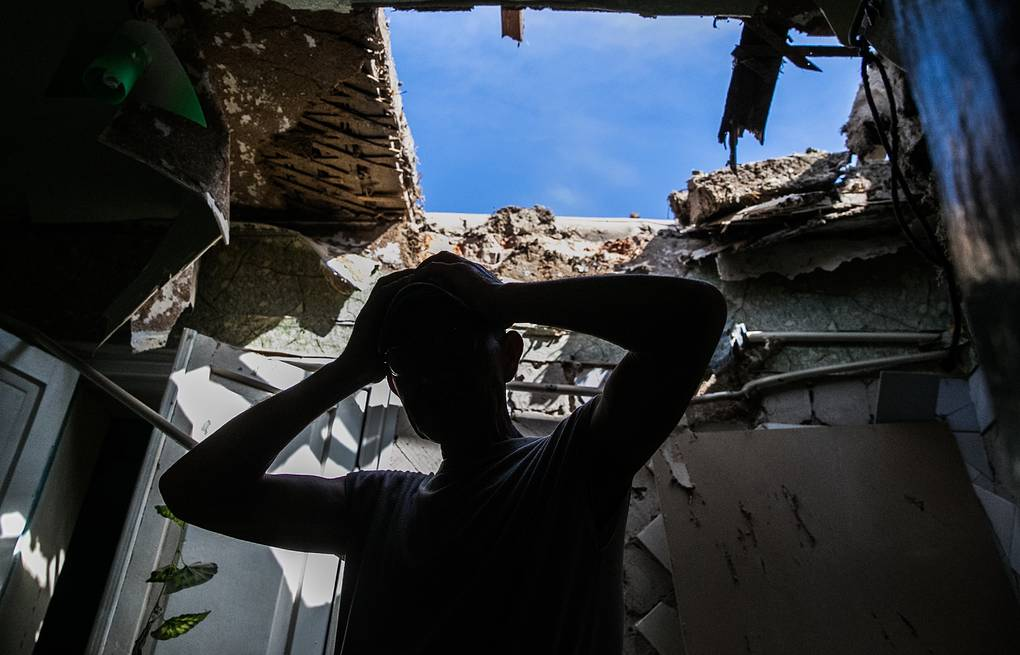 A house destroyed by Ukrainian army shelling in Sloviansk, May 2014 ITAR-TASS/Mikhail Pochuyev
