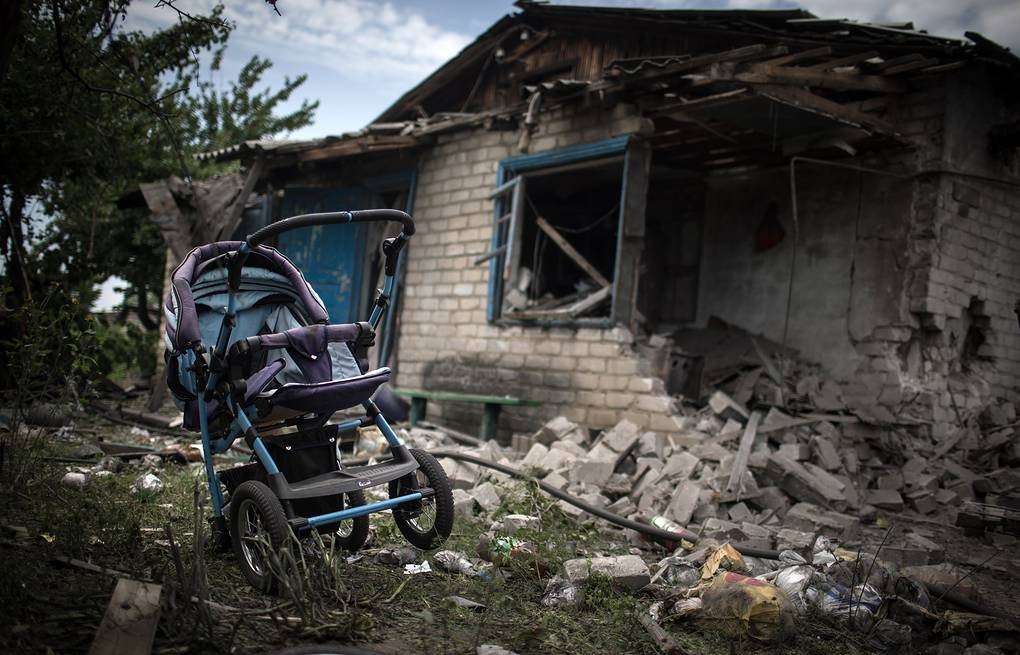 A house destroyed in an air strike carried out by Ukrainian armed forces  ITAR-TASS/Stanislav Krasilnikov