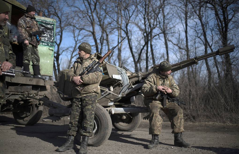 Ukrainian soldiers AP Photo/Evgeniy Maloletka