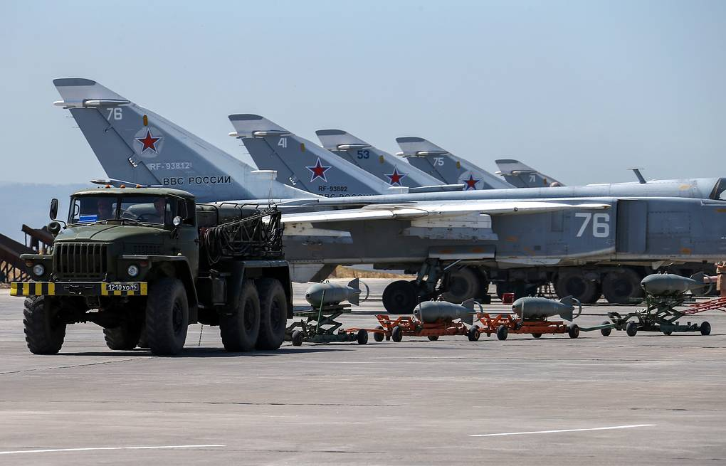 Russian fighter jets and bombers parked at Hmeimim air base in Syria Vadim Savitsky/Russian Defense Ministry Press Service pool photo via AP