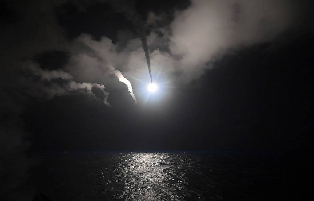 The guided-missile destroyer USS Porter (DDG 78) launches a tomahawk land attack missile in the Mediterranean Sea Mass Communication Specialist 3rd Class Ford Williams/U.S. Navy via AP