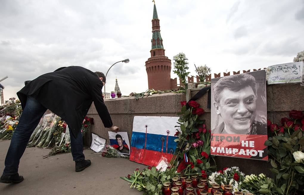 Flowers and candles left at a portrait of Boris Nemtsov in central Moscow, 2015 Sergei Savostianov/TASS