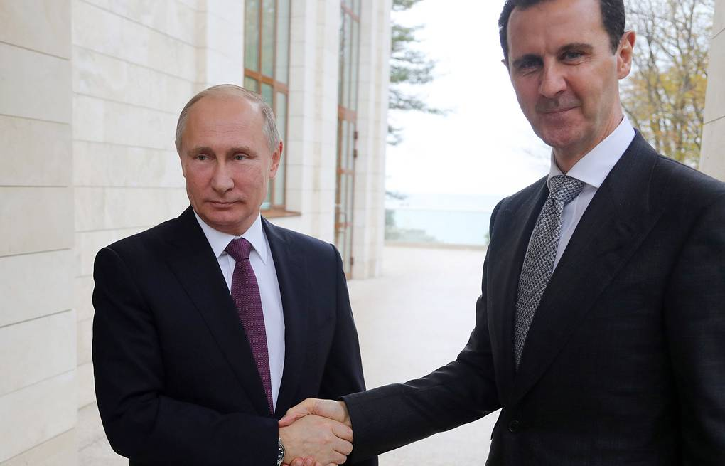 Russian and Syrian Presidents Vladimir Putin and Bashar al-Assad Mikhail Klimentyev/Russian Presidential Press and Information Office/TASS