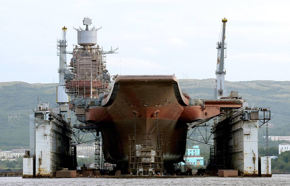 Russian aircraft carrier Admiral Kuznetsov at the PD-50 floating dock in Murmansk  Lev Fedoseyev/TASS