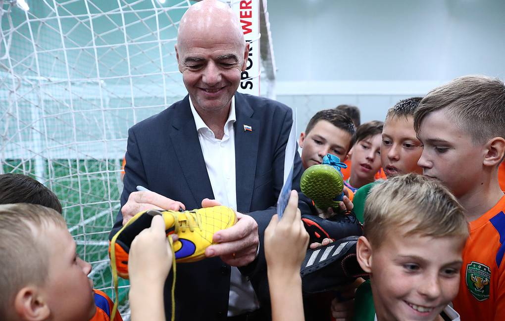 FIFA President Gianni Infantino signs autographs for children on his visit to sports school in Vladivostok Sergei Fadeichev/TASS