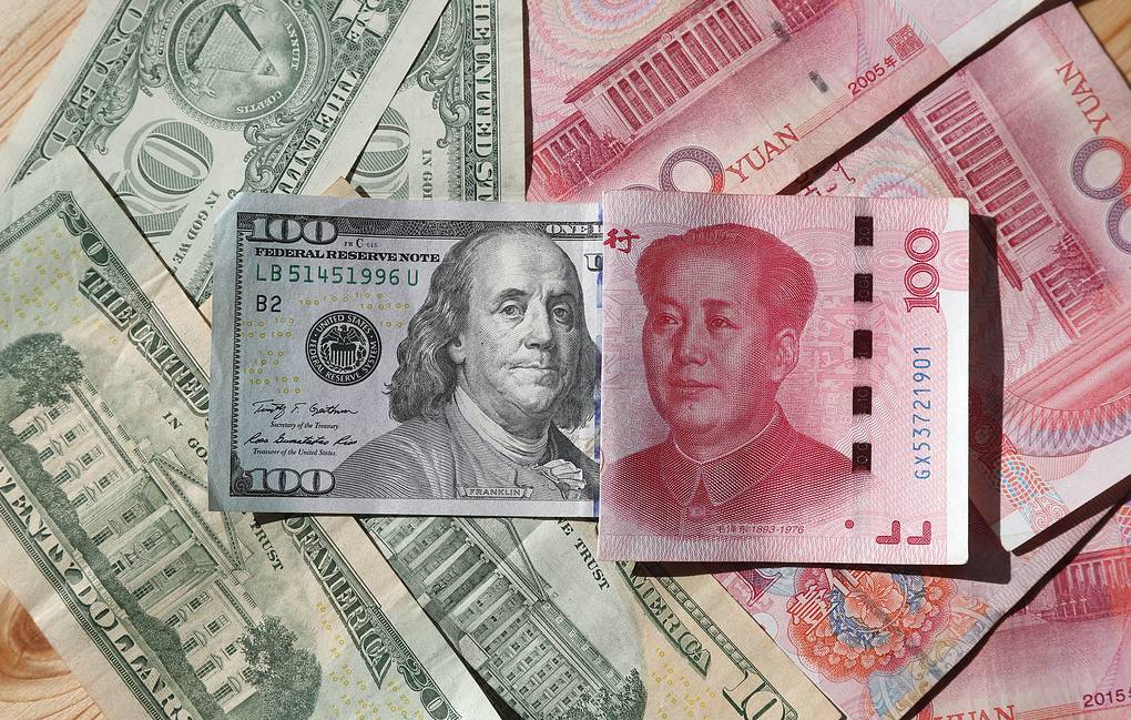 US dollar and China's yuan banknotes Yegor Aleyev/TASS