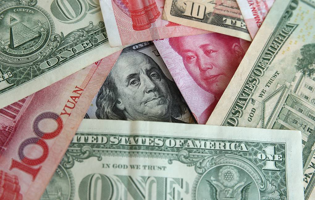 Banknotes of the US dollar and China's yuan  Yegor Aleyev/TASS