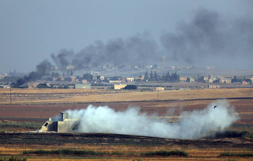Smoke is seen during bombardment by Turkish forces in northeastern Syria    AP Photo/Lefteris Pitarakis