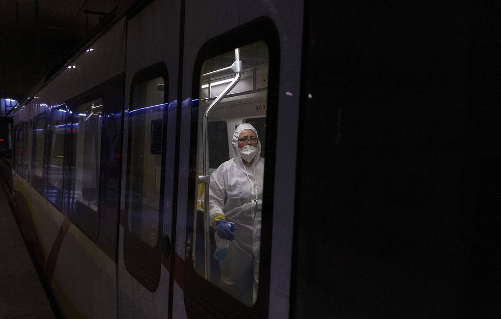 A worker cleaning a train in Palma de Mallorca, Spain AP Photo/Francisco Ubilla