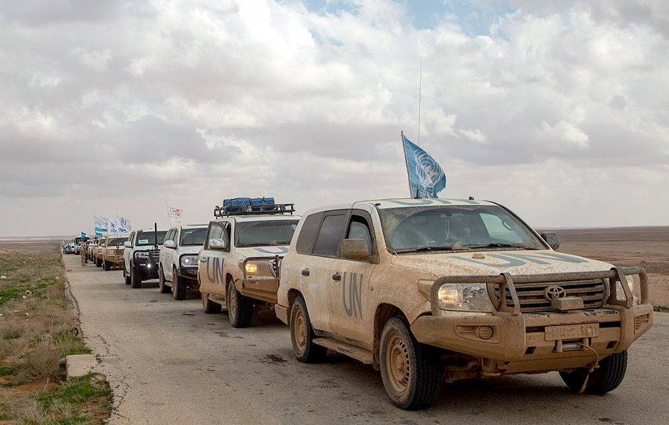 A humanitarian convoy organized by the UN Refugee Agency (UNHCR) arrives in Homs Konstantin Machulsky/TASS