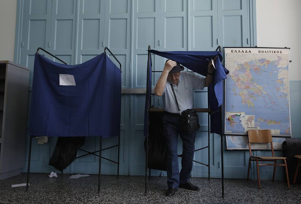 A man exits a voting booth to cast his ballot in a voting centre during a referendum in Athens, Greece, 05 July, 2015. Greek voters in the referendum are asked whether the country should accept reform proposals made by its creditors EPA/YANNIS KOLESIDIS