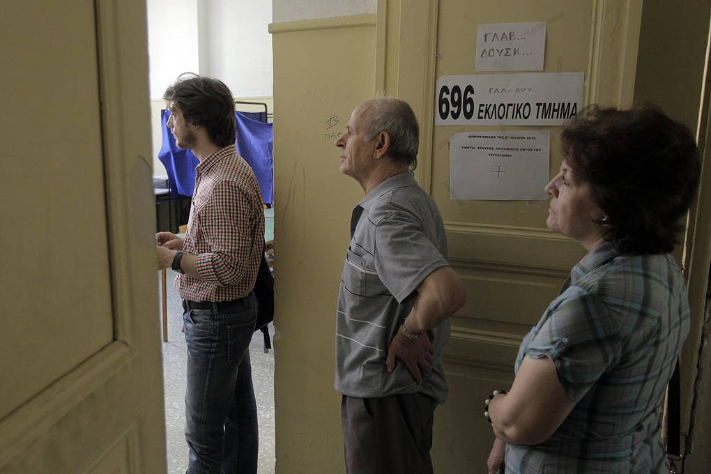 People wait in line to cast their ballot in a voting centre during a referendum in Athens, Greece, 05 July 2015. Greek voters in the referendum are asked whether the country should accept reform proposals made by its creditors. EPA/ORESTIS PANAGIOTOU