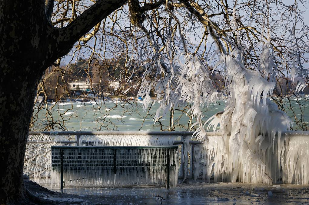 An ice covered bench is pictured at the frozen shore of Lake Geneva during a windy winter day, in Geneva, Switzerland, 26 February 2018. Media reports state that extreme cold weather is forecast to hit many parts of Europe with temperatures plummeting to a possible ten year low. EPA-EFE/VALENTIN FLAURAUD