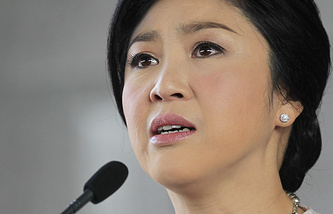 Thai Prime Minister Yingluck Shinawatra speaks to media during a press conference at the Thai Army Club in Bangkok