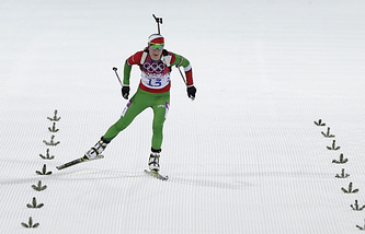 Belarus' Darya Domracheva skis on the finish straight during the women's 15K individual biathlon race