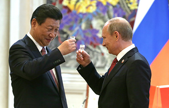 China's president Xi Jinping (L) and Russia's president Vladimir Putin seen after signing agreements May 25, 2014