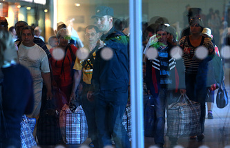 Ukrainian refugees at Domodedovo airport in Moscow