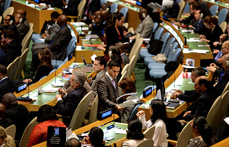 United Nations employees distribute ballots before delegates cast votes