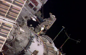 Cosmonauts during a spacewalk outside the International Space Station (archive)