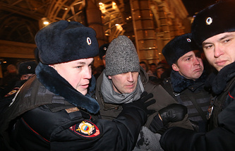 Alexey Navalny being detained in central Moscow