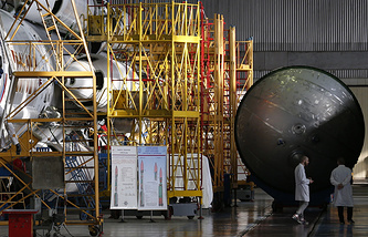 Assembling a Proton carrier rocket at Khrunichev State Research and Production Space Centre