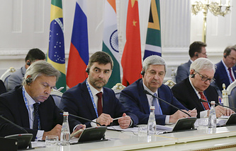 Alexey Pushkov, chairman of Russia's State Duma international affairs committee, Russian State Duma's deputy chairman Sergey Zheleznyak, Russian State Duma's first deputy chairman Ivan Melnikov and Russia's deputy foreign minister Sergey Ryabkov (L-R) attend the first BRICS Parliamentary Forum