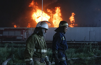 A fire is still burning at an oil depot outside Kiev