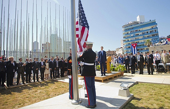 Secretary of State John Kerry, and other dignitaries watch as US Marines raise the US flag over the newly reopened embassy in Havana, Cuba