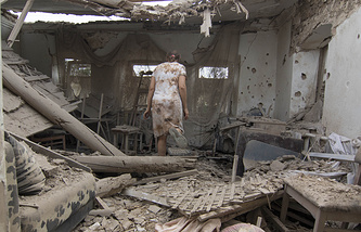 A woman in her house destroyed by shelling in Mariupol, Aug. 17
