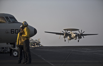 US Navy aircraft landing on the USS Theodore Roosevelt aircraft carrier in the Persian Gulf