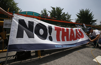 South Korean protester with a banner in front of the Defense Ministry in Seoul, South Korea