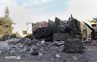 Damaged trucks carrying aid, in Aleppo