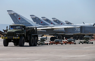 Russian fighter jets and bombers parked at Hmeimim air base in Syria