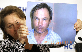 The mother of Russian pilot Konstantin Yaroshenko with his photograph