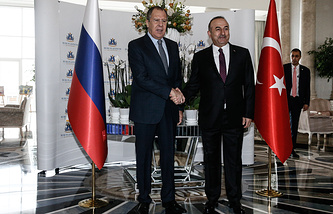 Russian and Turkish Foreign Ministers Sergey Lavrov and Mevlut Cavusoglu