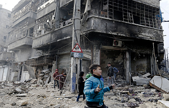 Syrian children in Bustan al-Qasr neighborhood in eastern Aleppo