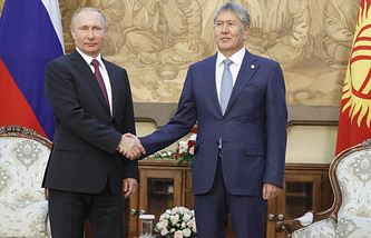 Russian President Vladimir Putin and Head of Kyrgyzstan Almazbek Atambayev
