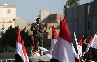 A Houthi militant stands guard during a rally in Sanaa, Yemen