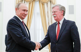 Russian President Vladimir Putin and US National Security Adviser John Bolton