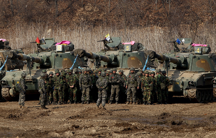 South Korean soldiers and tanks prepare for a drill