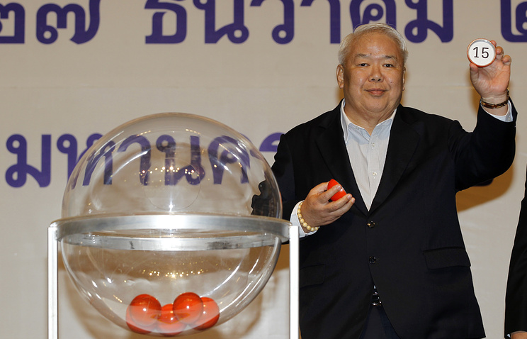 A representative of the ruling Pheu Thai Party draws the number of its party's election campaign
