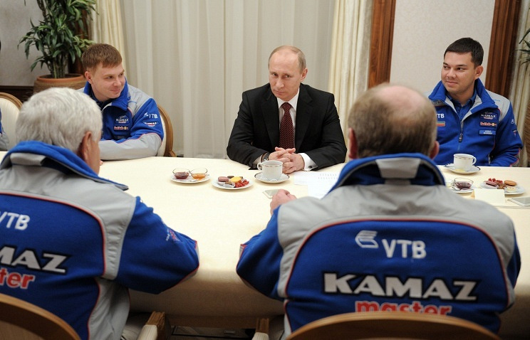 Russian President Vladimir Putin meets with members of Russia's truck team KAMAZ-Master